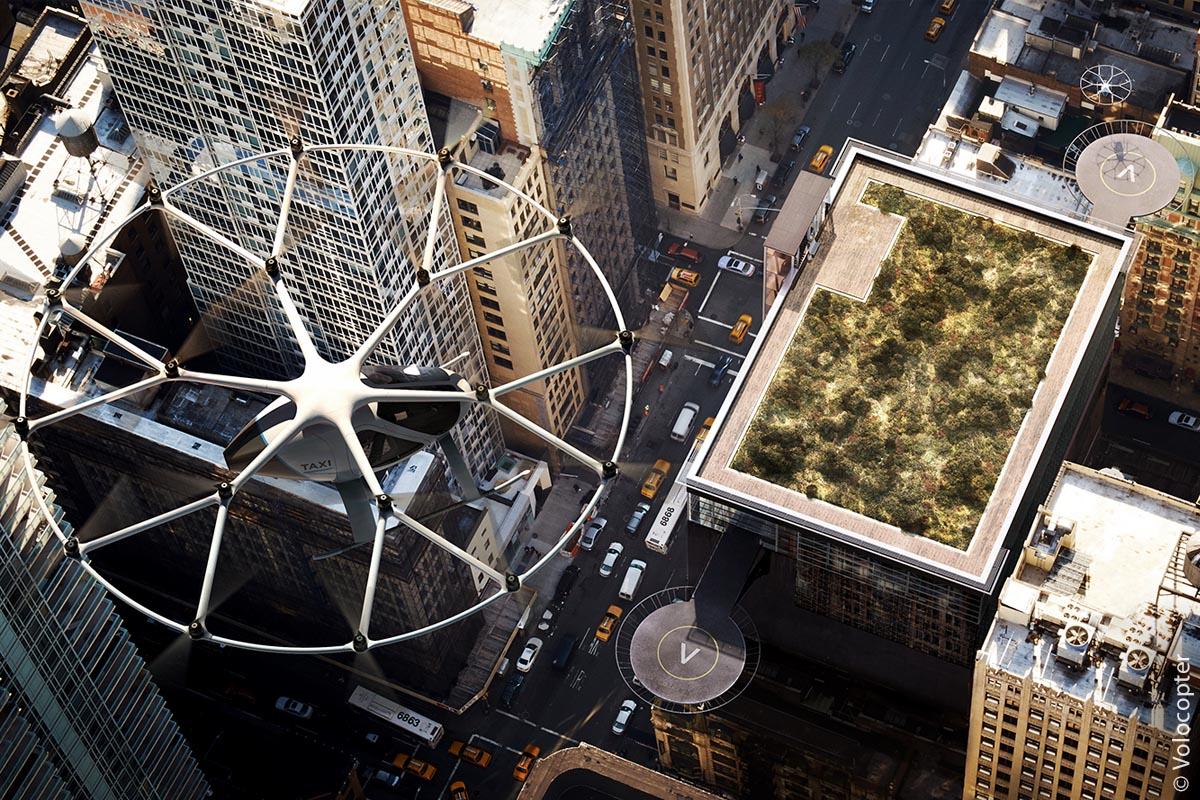 """Große Plattformen an den Fassaden von Hochhäusern dienen Volocoptern als Landeplatz und sind mit einem """"V"""" gekennzeichnet."""