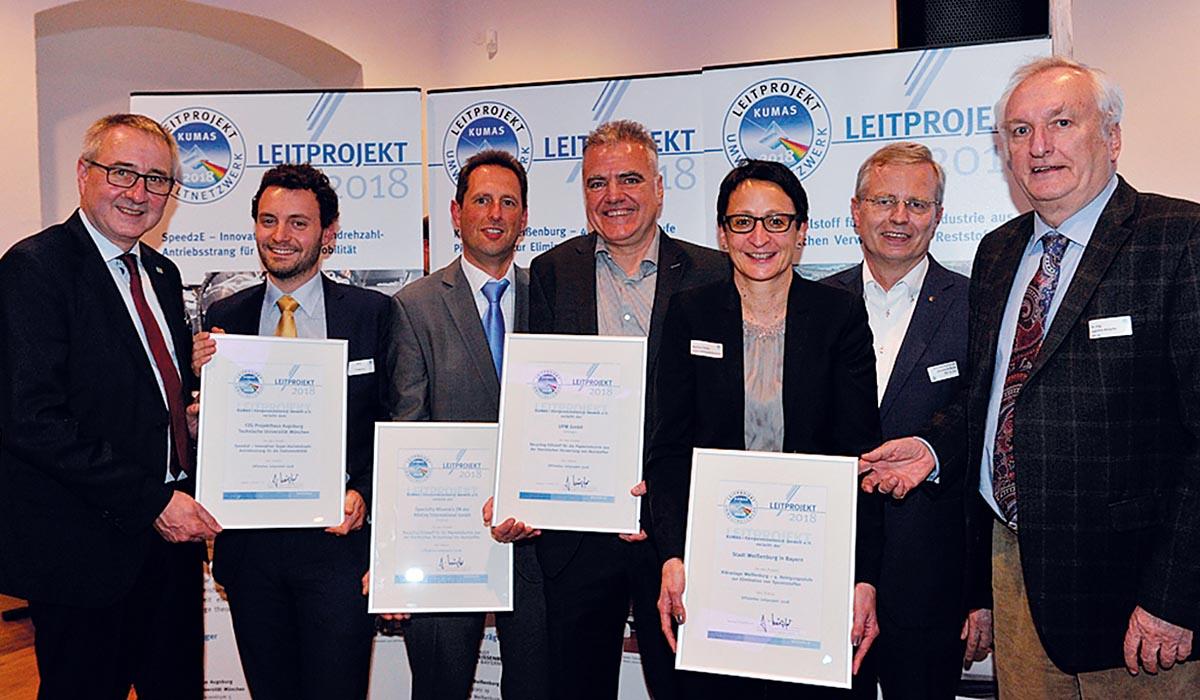 """Verleihung der Auszeichnung der """"KUMAS-Leitprojekte 2018"""" im letzten Jahr an die Preisträger"""